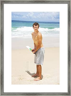 Beach Cricketer Framed Print