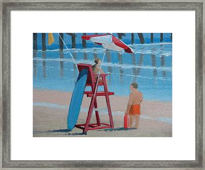 Beach Guards On Duty Framed Print by Robert Rohrich