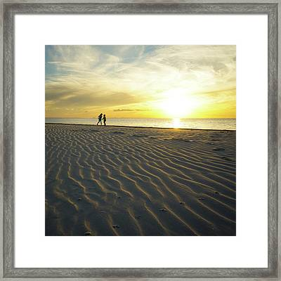 Beach Silhouettes And Sand Ripples At Sunset Framed Print