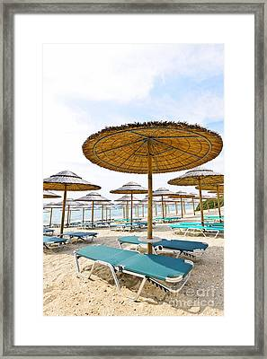 Beach Umbrellas And Chairs On Sandy Seashore Framed Print