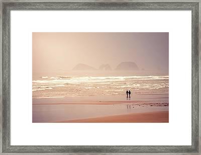 Beach Walkers Framed Print by Debi Bishop