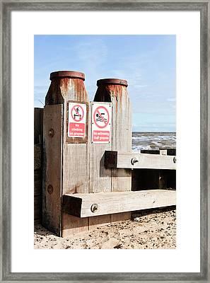 Beach Warning Framed Print by Tom Gowanlock