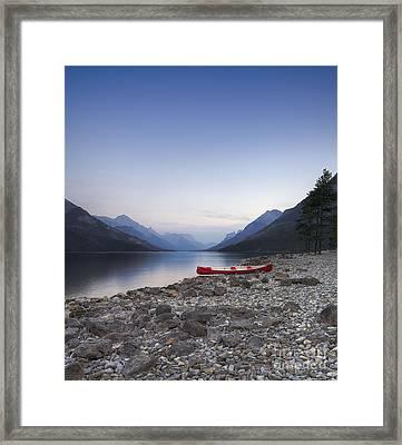 Beached Canoe Awaits Nightfall Framed Print by Royce Howland