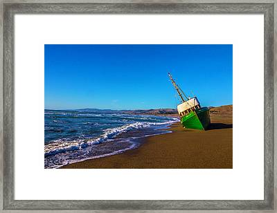 Beached Green Fishing Boat Framed Print by Garry Gay