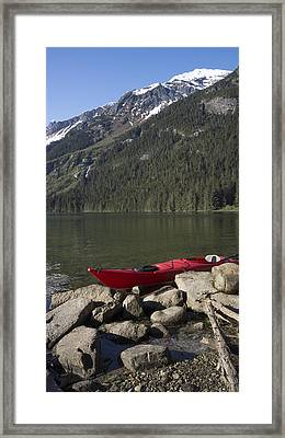 Beached Kayak In Alaska Framed Print