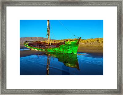 Beached Worn Green Fishing Boat Framed Print by Garry Gay