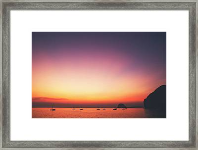 Beautiful And Serene Sunset View Over A Lagoon Bay With Couple Of Yachts And Islands In Distance Framed Print