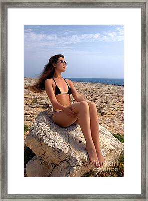 Beautiful Sexy Woman In Bikini Relaxing On A Rocky Seashore Framed Print by Oleksiy Maksymenko