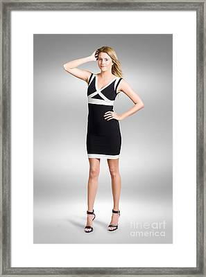 Beautiful Woman Wearing Black And White Dress Framed Print by Jorgo Photography - Wall Art Gallery