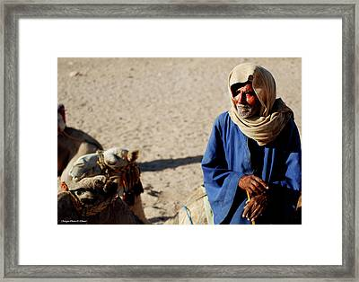 Bedouin Man In Blue Framed Print by Chaza Abou El Khair