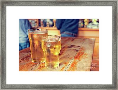 Framed Print featuring the photograph Beers In A Pub by Patricia Hofmeester