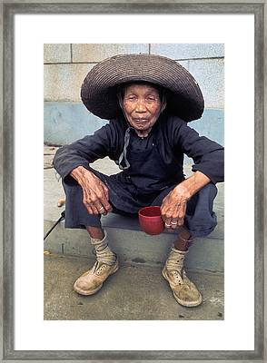 Begger Woman In Western China Framed Print by Carl Purcell