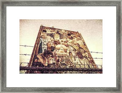Behind Barbed Wire Framed Print