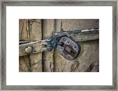 Behind Locked Doors Framed Print by Martin Newman