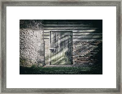 Behind The Door Framed Print