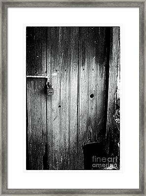 Behind The Locked Door Framed Print by John Rizzuto