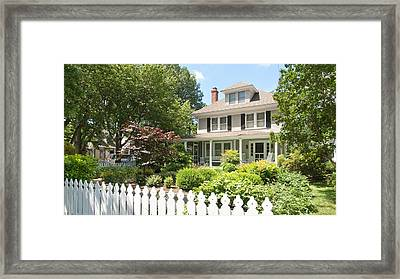 Behind The Picket Fence Framed Print