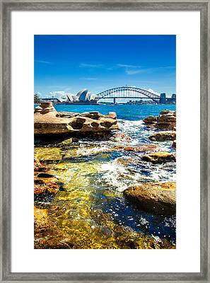 Behind The Rocks Framed Print
