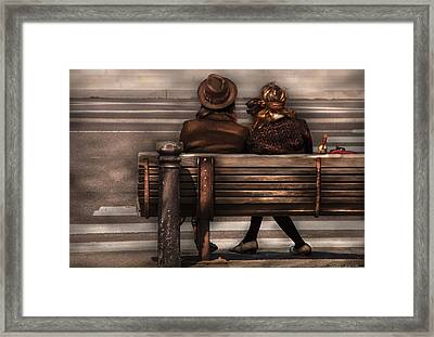 Bench - A Couple Out Of Time Framed Print by Mike Savad
