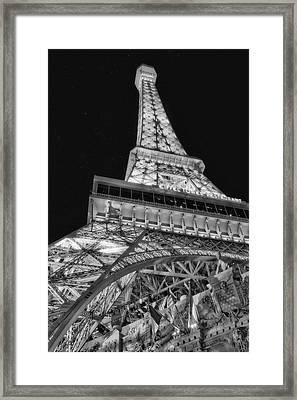 Beneath The Eiffel Tower Framed Print by Susan Candelario