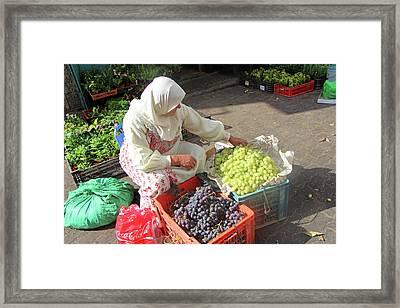 Bethlehem Grapes Seller Framed Print by Munir Alawi