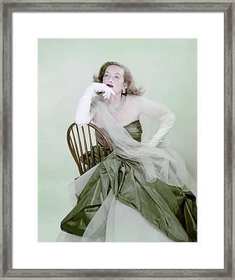 Bette Davis In Green Framed Print by Erwin Blumenfeld