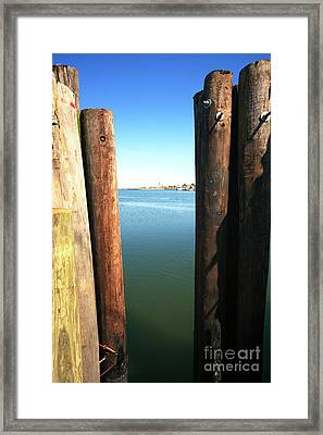 Between The Dock Poles At Long Beach Island Framed Print by John Rizzuto