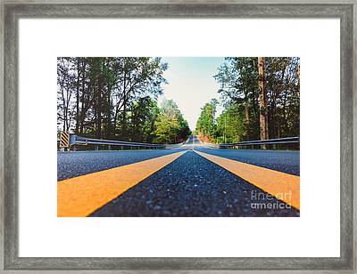 Between Yellow Lines Framed Print