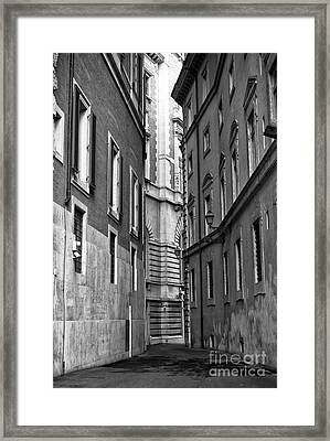 Beyond The Building In Roma Framed Print by John Rizzuto