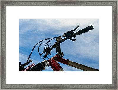 Bicycle Handle Bars Against Blue Sky Framed Print