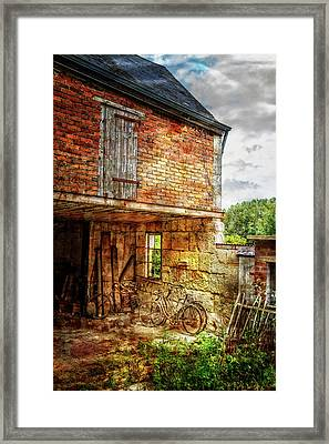 Bicycles In The Courtyard Framed Print