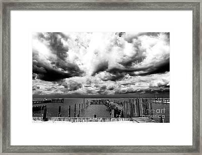 Big Clouds Little Dock Framed Print by John Rizzuto