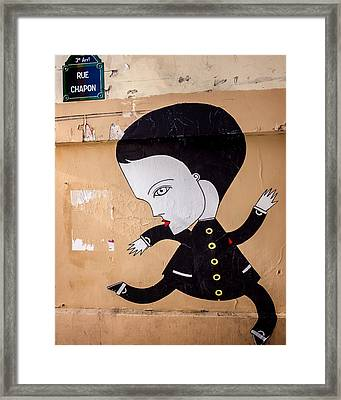 Big Head On Rue Chapon Framed Print