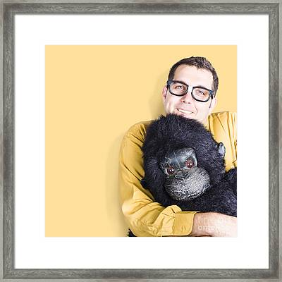 Big Male Goof Cuddling Toy Gorilla. Comfort Zone Framed Print by Jorgo Photography - Wall Art Gallery
