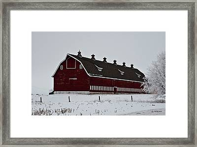 Big Red Barn In The Winter Framed Print by Edward Peterson