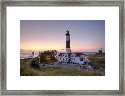 Big Sable Point Lighthouse At Sunset Framed Print by Adam Romanowicz