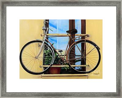 Bike In The Window Framed Print