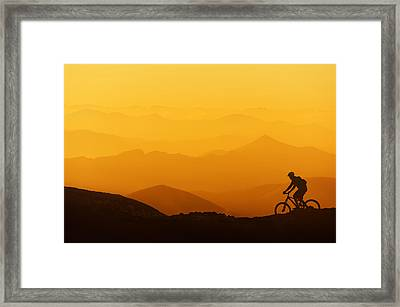 Biker Riding On Mountain Silhouettes Background Framed Print