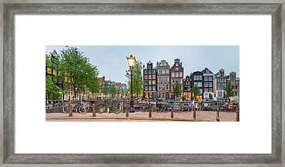 Bikes And Houses Along Canal At Dusk Framed Print by Panoramic Images