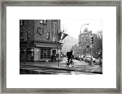 Biking In Greenwich Village Framed Print by John Rizzuto