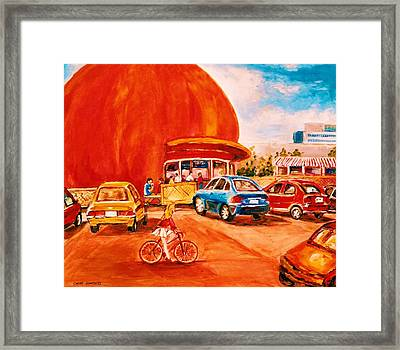 Biking Past The Orange Julep Framed Print by Carole Spandau