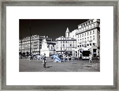 Biking Through The Port Framed Print by John Rizzuto