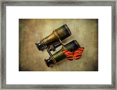 Binoculars And Butterfly Framed Print by Garry Gay