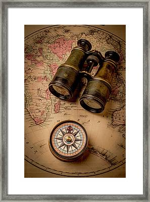 Binoculars And Compass On Map Framed Print by Garry Gay