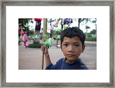 Bird Selling Boy Framed Print