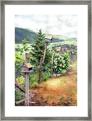 Birdhouse Alley Framed Print by Leslie Redhead