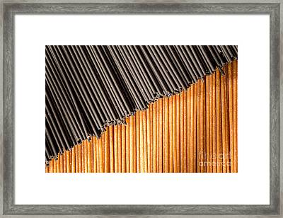 Black And Brown Spaghetti Sticks Togehter. Framed Print by Jacques Jacobsz