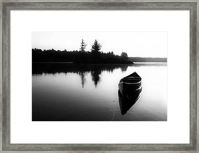 Black And White Canoe In Still Water Framed Print