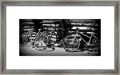 Black And White Leaning Bikes Framed Print by Emily Kelley
