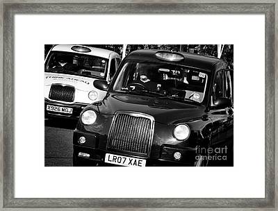 Black And White London Taxi Cabs Framed Print by Andy Smy